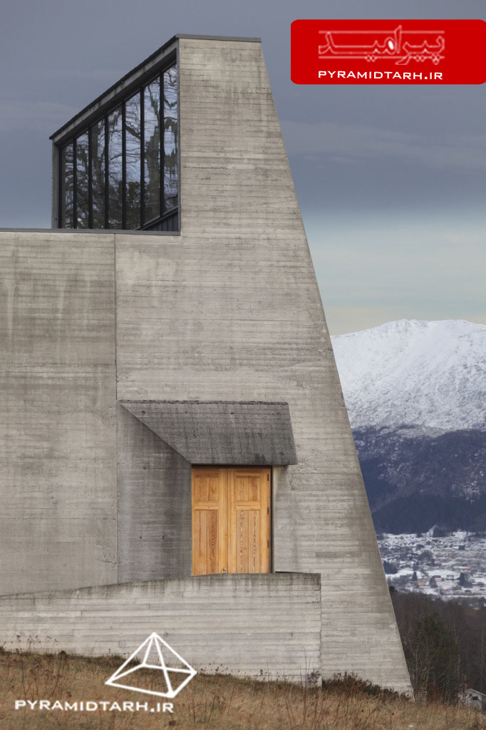 Ivar Aasen Centre, Museum, Orsta Norway, Sverre Fehn 2000 (detail of shuttered concrete exterior with wooden door glowing in late afternoon light, with snowy mountains beyond)